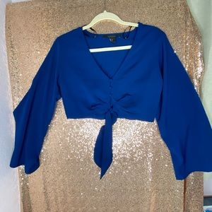 Blue cropped blouse with button+tie front